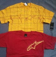 Two Alpinestars Shirts yellow heart beat and red grip t shirts small Bundle of 2