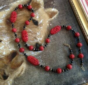 """A Vintage Chinese Cinnabar 30"""" long carved bead Necklace / clasp."""