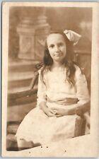 Vintage RPPC Real Photo Postcard Girl Hair Bow Dress Chair Studio Portrait 1920s