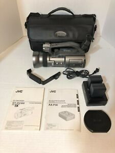 JVC GY-DV300 Mini DV Camcorder bundle with charger, batteries, and bag