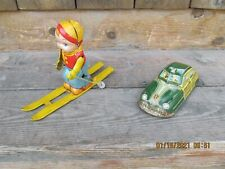 Two Metal Wind up Toys One car and one skier