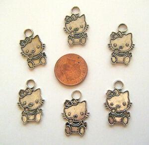 6 tibetan silver Hello Kitty charms
