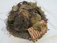 ORIGINAL WW 2 CAMOUFLAGED HELMET AND FIRST AID DRESSING