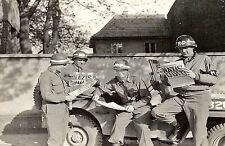 WW2 Picture Photo U.S. military policemen read about the German surrender 1123