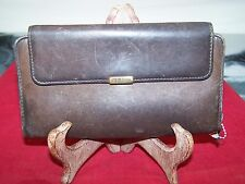 BUXTON VELVET TOUCH COWHIDE EXTERIOR BROWN SNAP BUTTON AND ZIP AROUND WALLET