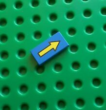 LEGO 3069bp06 1 X 2 TILE BLUE LONG YELLOW ARROW. From sets 6845, 6931, 6872 etc