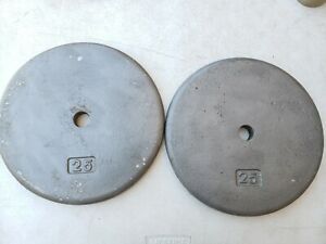 """2 x 25 LB Standard size Pancake weight Plates 1"""" Weights used cast iron 25lb"""