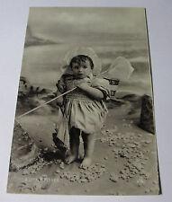 K250 1905 BABY GIRL Little Fisher TODDLER on BEACH POSTCARD Tucks Silverette RP