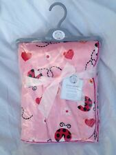 SOFT FLEECY BABY WRAP OR BLANKET 75CMS X 100CMS PINK WITH LADYBIRDS