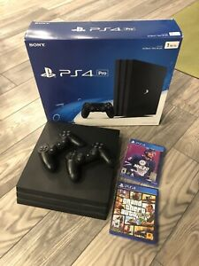 Sony PlayStation 4 Pro 1TB Console with 2 controllers and 2 New Games