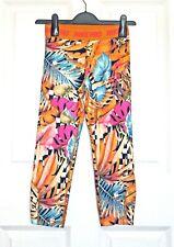Nike Pro Dri Fit girl's sports leggings with orange &multi floral print12/13 yrs