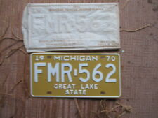 Set of Two 1970 Michigan License Plates w/sleeve - Oakland University - FMR 562