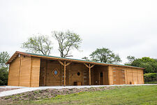 Prestige Log Stables block with tractor store tack room and living accomodation.
