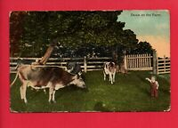 DOWN ON THE FARM BOY WITH COWS FENCE POSTCARD