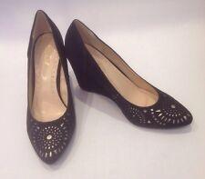 Bamboo high heel wedge with peekaboo cutaway on toe. black suede like fabric