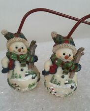 Snowman two candle Snuffer's three inches tall and 10 inch handles Christmas