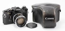 (29) Canon F-1 film camera w/50/1.4 lens, cap, leather case, fantastic condition
