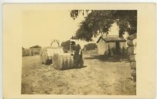 CANDID FARM SCENE antique real picture postcard photo rppc WOMAN ON HAY BALES