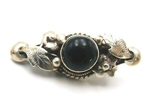 Small sterling silver and onyx brooch with decorative leaves and berries