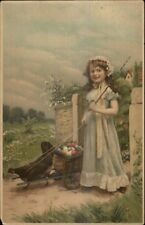 Easter - Little Girl w/ Chicken Pulling Wagon Basket of Eggs c1910 Postcard
