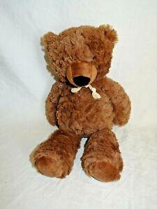Sainsburys dark brown teddy bear with string bow around neck