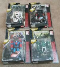 Transformers Generazioni Combinatore GUERRE Hound Wheeljack CORTINA FUMOGENA Trailbreaker