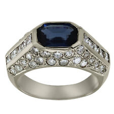 Sapphire Ring With Blue Sapphire Emerald Cut And Princess Cut And Pave Diamonds