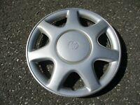 One genuine 1993 1994 1995 Toyota Corolla 14 inch wheel cover hubcap