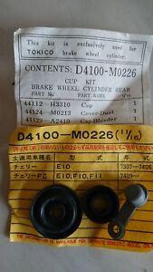 Datsun Cherry E10 F10, rear wheel cylinder repair kit, 11/16 bore, new genuine.