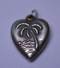ANTIQUE VICTORIAN STERLING SILVER HEART CHARM WITH REPOUSSÉ RAISED PALM TREE