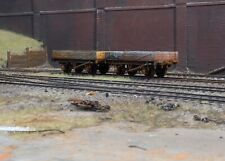 OO gauge abandoned open wagons, heavily rusted and weathered