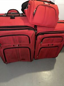 Delsey Luggage Set Red used suitcases zipper up