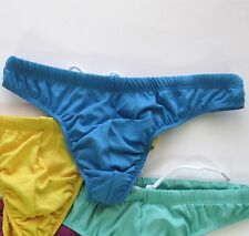 TurquoiseWhite Men\u2019s Slide Pouch Thong Swimsuit