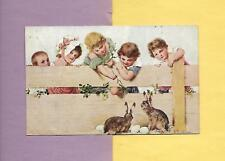 CHILDREN FEED BUNNIES On Colorful A/S R. R. VIENERN Vintage 1909 EASTER Postcard