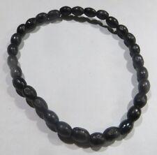 Bracelet sur élastique avec perles olive noires