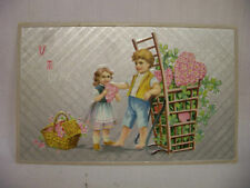 VINTAGE EMBOSSED VALENTINES POSTCARD BOY AND GIRL W/BASKETS OF HEART FLOWERS