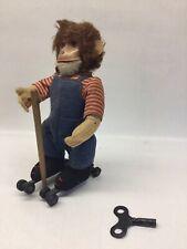 Vintage Schuco Rolly Wind Up Roller Skating Monkey