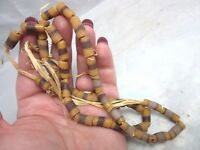 Vintage African trade beads. Yellow w/ brown stripe glass