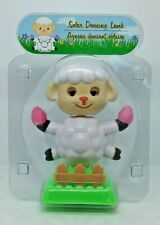 Solar Dancing Lamb Holding Easter Eggs with Fence