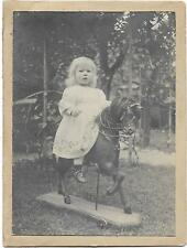 Photo CAB cute girl on horse on wheels toy 1900 CAB008