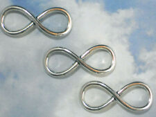 10 Infinity Charms Connector Links Silver Tone Loops 35mm Pretzel #P1234B