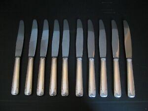 *2975* 10 couteaux en métal argenté art deco ancien