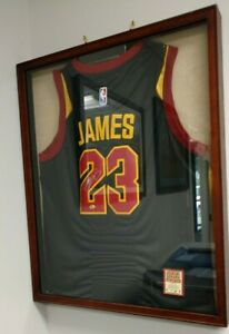 lebron james jersey signed authenticated. in wooden shadowbox