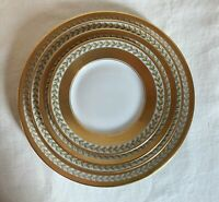WM Guerin Limoges 4 piece dinnerware set. Smooth gold band,green laurel leaf.