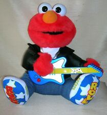 1997 Rock & Roll Elmo New in Box  Tyco / The Jim Henson Co.  Sings 4 songs