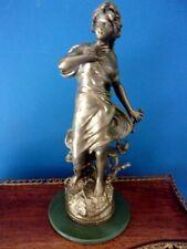 Statue régule à patine bronze - Femme à la libellule signée ROUSSEAU