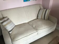 Sofa bed, two seater in cream fabric and very good condition