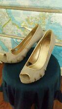 Fioni tan 4 inch heels size 8.5, peep toe pumps, very cute!
