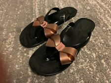 """Ted Baker """"Suszie"""" Black Flip Flops With Gold Bow At The Front"""
