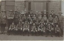 Scout Master wearing Victorian campaign medals with his Scout Troop in street